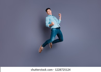 Full length body size portrait of nice cool attractive handsome cheerful optimistic man wearing blue formal shirt flying in air rejoicing isolated over pastel grey violet background