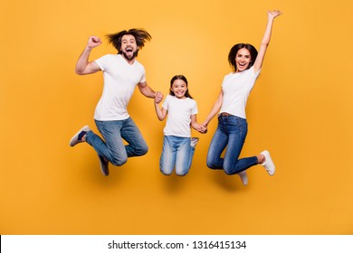 Full length body size portrait of nice lovely charming attractive positive cheerful people dad mom spending free time holding hands isolated over shine vivid pastel yellow background