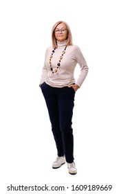Full length body size portrait of stylish attractive pretty charming cheerful senior age lady holding hands in pockets with shell necklace over white background. Concept of age and fashion