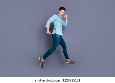 Full length body size profile side view portrait of nice cute attractive handsome cheerful positive man wearing blue formal shirt flying in air strolling isolated over pastel grey violet background