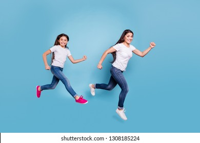 Full length body size profile side view of two nice crazy sweet lovely attractive cheerful funny slim people in white t-shirt jeans denim rush hour isolated over blue pastel background