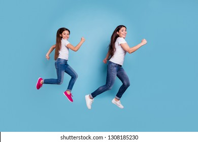 Full length body size profile side view of two nice sweet lovely attractive cheerful cheery funny slim sporty people in white t-shirt having fun isolated over blue pastel background