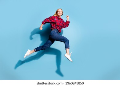 Full length body size profile side view portrait of nice charming attractive cheerful cheery girl wearing checked shirt having fun isolated on teal turquoise bright vivid shine background