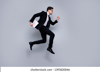 Full length body size profile side view portrait of his he nice attractive purposeful guy executive manager consultant economist carrying laptop career growth isolated over light gray background