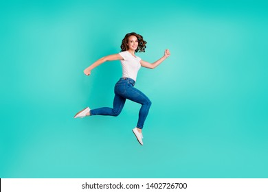 Full length body size profile side view of her she nice attractive lovely cheerful cheery strong wavy-haired lady going for a walk isolated on bright vivid shine blue background
