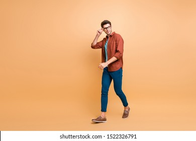 Full length body size profile side view of his he nice attractive trendy calm brunette guy business assistant shark expert touching specs walking isolated over beige color pastel background - Shutterstock ID 1522326791