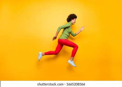 Full length body size profile side view of nice attractive lovely cheerful cheery wavy-haired girl jumping running active life isolated over bright vivid shine vibrant yellow color background
