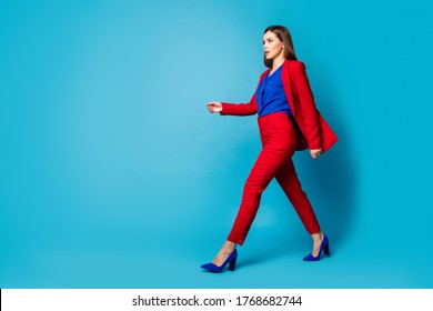 Full length body size profile side view of her she nice-looking attractive fascinating pretty fashionable office lady walking isolated over bright vivid shine vibrant blue color background