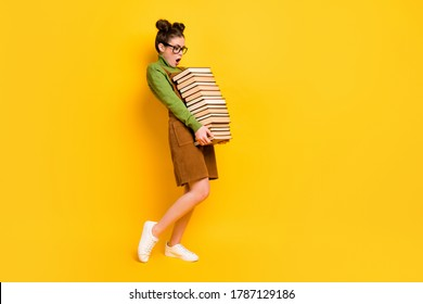 Full length body size profile side view of her she attractive overwhelmed intellectual girl carrying many book science isolated bright vivid shine vibrant yellow color background