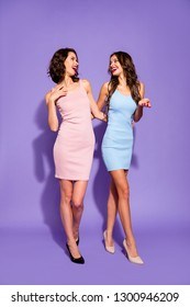 Full length body size vertical view photo two stunning she her ladies ready for girls party prom night main theme of weekend wear festive dresses isolated purple violet vivid vibrant background