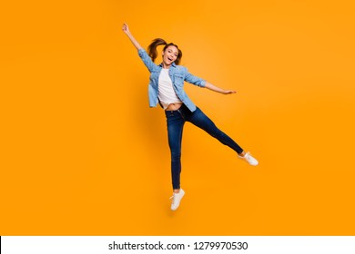 Full length body size view of nice attractive lovely slim sporty fit cheerful cheery school girl hanging like holding umbrella isolated over bright vivid shine yellow background