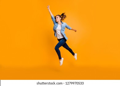 Full length body size view of nice attractive slim sporty sportive fit thin school girl raising hand looking up in air excellent result isolated over bright vivid shine yellow background