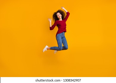 Full length body size view of her she nice-looking pretty attractive cheerful cheery feminine slim thin fit wavy-haired lady jumping up in air rejoice isolated on bright vivid shine orange background