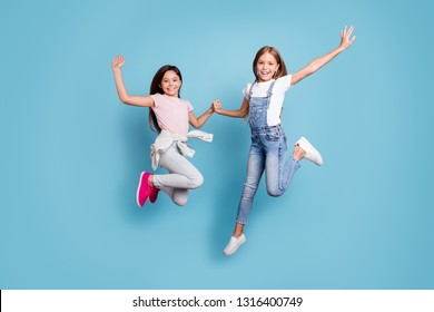 Full length body size view of two people nice-looking crazy cute lovely attractive cheerful careless straight-haired pre-teen girls having fun great day overjoy isolated over blue pastel background