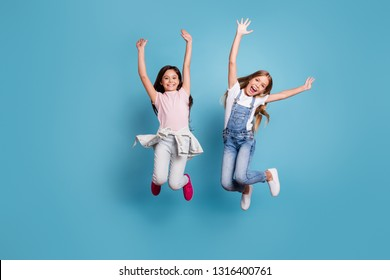 Full length body size view of two people attractive charming cheerful careless carefree straight-haired pre-teen girls having fun party overjoy great weekend day isolated on blue pastel background