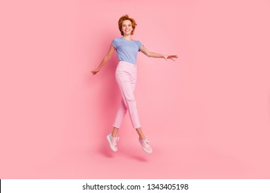 Full length body size view of her she nice cute charming attractive winsome lovely cheerful cheery feminine girl wearing casual walking on air having fun isolated on pink pastel background