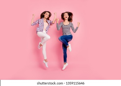 Full length body size view photo of funny active fellows fellowship scream laugh shout yes laughter raise fists satisfied feel rejoice isolated pastel background wear denim checkered outfit