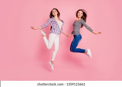 Full length body size view photo of cute pretty students millennial having walk fooling isolated feeling freedom hold hand excited dressed denim checkered clothes on rose-colored background