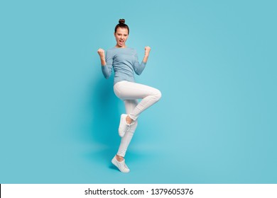Full length body size view photo careless carefree playful satisfied lady scream yeah raise hands fists luck lucky lottery aims funny funky pullover white trousers sneakers isolated blue background