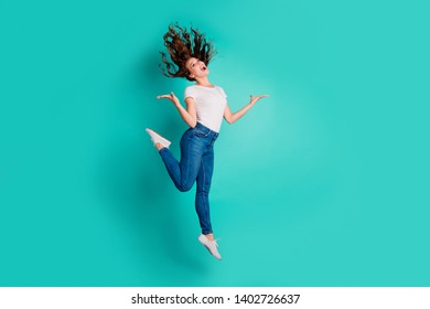 Full length body size view of nice-looking attractive lovely winsome cheerful cheery wavy-haired lady having fun rejoice best luck isolated on bright vivid shine blue background