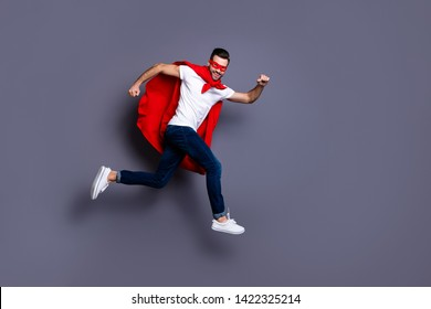 Full length body size view of his he nice-looking attractive content cheerful cheery glad virile masculine sportive macho bearded guy running marathon isolated over gray pastel background