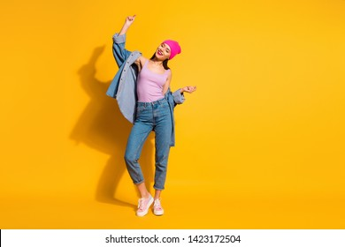 Full length body size view photo charming youth model free time vacation enjoy holiday occasion nightlife night life person wear fashionable she her outfit sneakers isolated yellow bright background