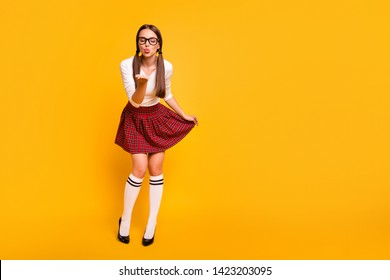 Full length body size view portrait of nice-looking attractive lovely tender sweet winsome feminine girl wearing uniform sending kiss closed eyes isolated on bright vivid shine yellow background