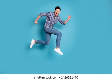 Full length body size  view photo handsome cute millennial shout wow omg unbelievable unexpected fan free time holidays weekend wear checkered shirt denim sneakers isolated blue background