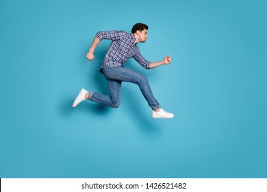 Full length body size view of concentrated athlete coach trainer do workout dressed fashionable outfit checked shirt denim sneakers isolated on blue background