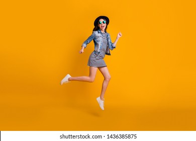 Full length body size view photo careless carefree childish millennial summer travel vacation laughter scream celebrate specs eyewear eyeglasses striped jeans denim clothes isolated vivid background