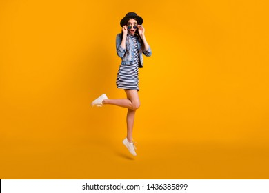 Full length body size view photo charming carefree youth people millennial astonished impressed incredible unbelievable unexpected information striped jeans clothing isolated yellow background weekend