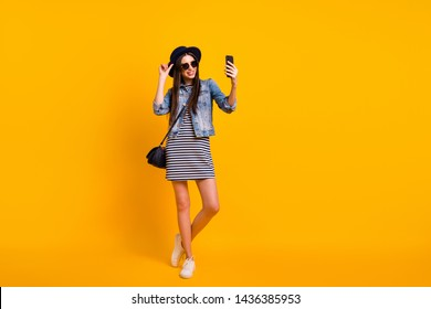 Full length body size view portrait of nice-looking charming attractive lovely fascinating cheerful cheery straight-haired lady taking selfie isolated over bright vivid shine yellow background