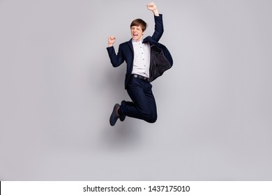 Full length body size view photo of nice ecstatic child children raise fists scream shout yes yeah have aims achievement dressed black white blazers jackets trousers isolated grey background