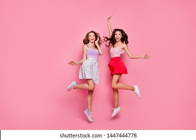 Full length body size view of nice-looking smart attractive charming lovely lovable careless carefree cheerful cheery girls having fun free spare time day isolated over pink pastel background