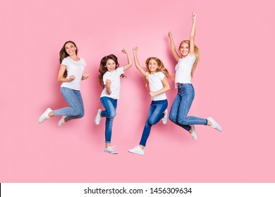 Full length body size view of four nice attractive trendy slim fit cheerful glad overjoyed excited positive long hair girls having fun rejoicing funky mood motherhood isolated on pink background