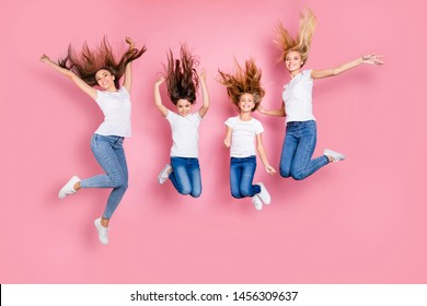 Full length body size view of four nice attractive careless slim fit cheerful long hair glad girls having fun rejoicing carefree life life style funky mood motherhood isolated over pink background