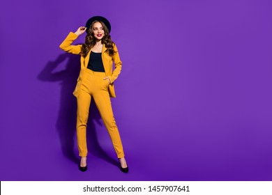 Full length body size view of her she nice-looking gorgeous attractive lovely cheerful cheery content wavy-haired lady touching fixing sunhat isolated over bright vivid shine violet lilac background