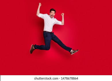 Full length body size view of his he nice attractive lovely cheerful cheery content overjoyed guy having fun rejoicing isolated over bright vivid shine red background