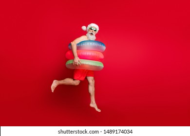 Full length body size view of nice handsome cheerful cheery funky glad positive comic childish playful wondered bearded gray-haired man hurry rush isolated on bright vivid shine red background