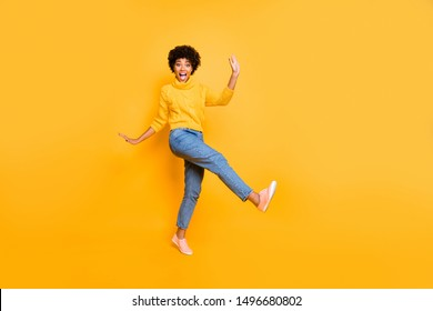 Full length body size view of her she nice attractive cheerful cheery playful comic wavy-haired girl having fun free time fooling isolated on bright vivid shine vibrant yellow color background