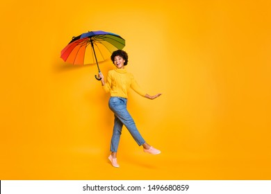 Full length body size view of her she nice attractive cheery wavy-haired girl holding in hand parasol having fun walking spending autumn isolated on bright vivid shine vibrant yellow color background
