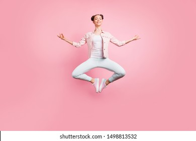 Full length body size view portrait of her she nice attractive charming lovely slender careless cheerful cheery girl practicing yoga class isolated over pink pastel background