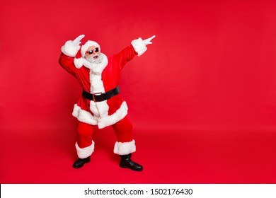Full length body size view of his he nice attractive cheerful cheery careless bearded Santa having fun rejoicing fairy eve noel isolated over bright vivid shine red background