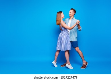 Full length body size view of her she his he two nice-looking attractive charming cheerful people dancing waltz isolated over bright vivid shine vibrant blue turquoise color background