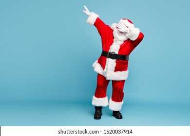 Full length body size view of his he nice cool fat bearded Santa wearing warm winter coat look outfit dancing dab moves isolated over blue turquoise pastel color background