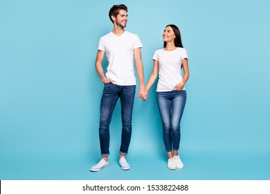 Full length body size view of his he her she nice attractive charming pretty cute sweet cheerful life partners holding hands isolated over bright vivid shine vibrant blue green turquoise background