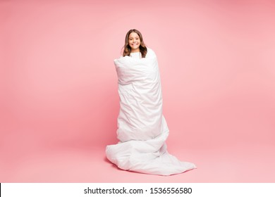 Full length body size view of her she nice attractive cute cheerful cheery wavy-haired pre-teen girl standing wrapped covered in soft white blanket isolated over pink pastel color background