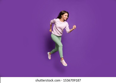Full length body size view of her she nice attractive charming lovely winsome slim fit thin cheerful girl jumping running isolated over bright vivid shine vibrant purple violet lilac color background