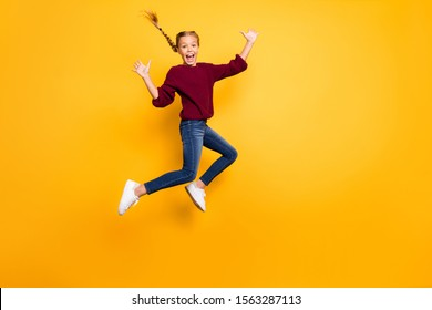Full length body size view of her she nice attractive lovely crazy overjoyed glad girlish cheerful pre-teen girl jumping having fun isolated on bright vivid shine vibrant yellow color background