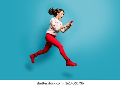 Full length body size view of nice attractive cheerful amazed impressed girl jumping using 5g like follow subscribe running hurry rush isolated on bright vivid shine vibrant blue color background